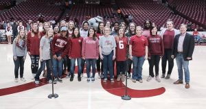women's chorus performing at UA basketball game