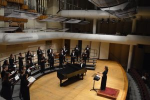 Graduate choral education student conducting the chamber choir